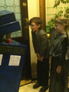 Mini TARDIS with mini Doctor Who and mini Weeping Angel.